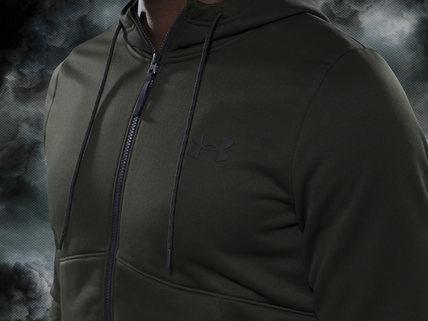 olive green under armour track top on a stormy background