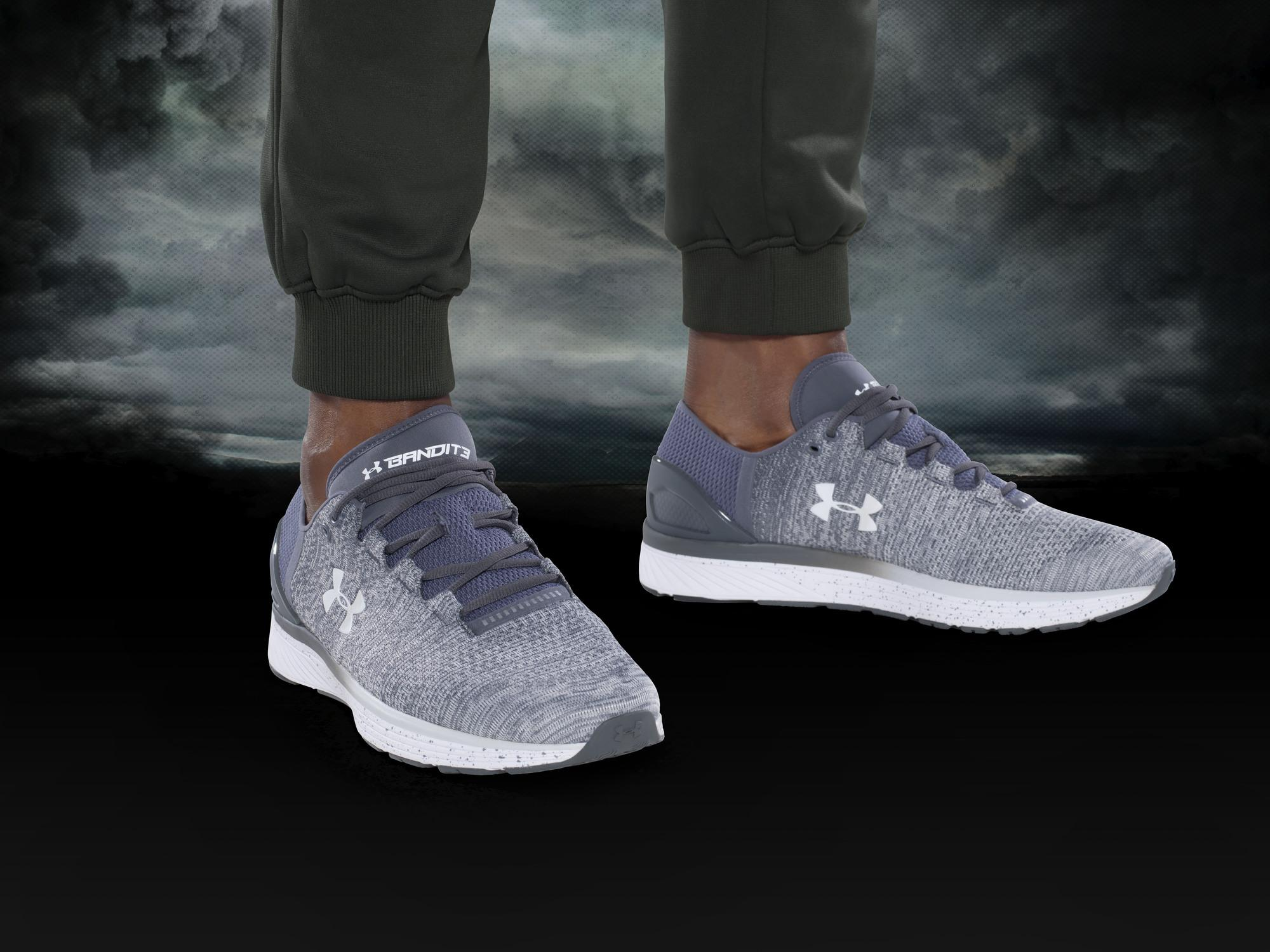 grey trainers and olive green under armour sportswear on a stormy background