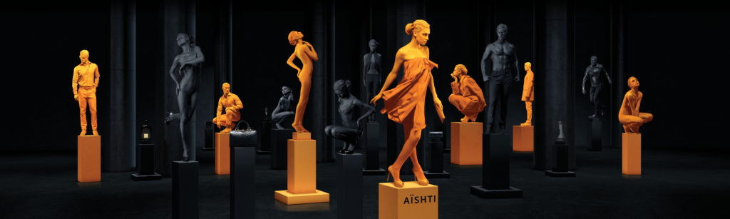 fashion models painted orange and black on plinths