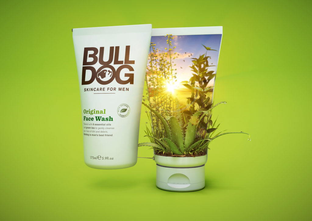 cgi bulldog face wash bottle open in half to show plants in a field at sunrise