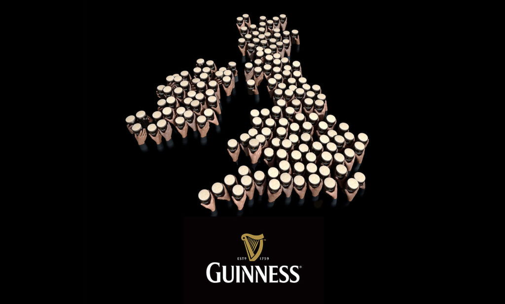 hands holding pints of Guinness to form the British Isles