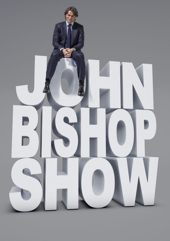 John Bishop sitting on large cgi white text John Bishop Show