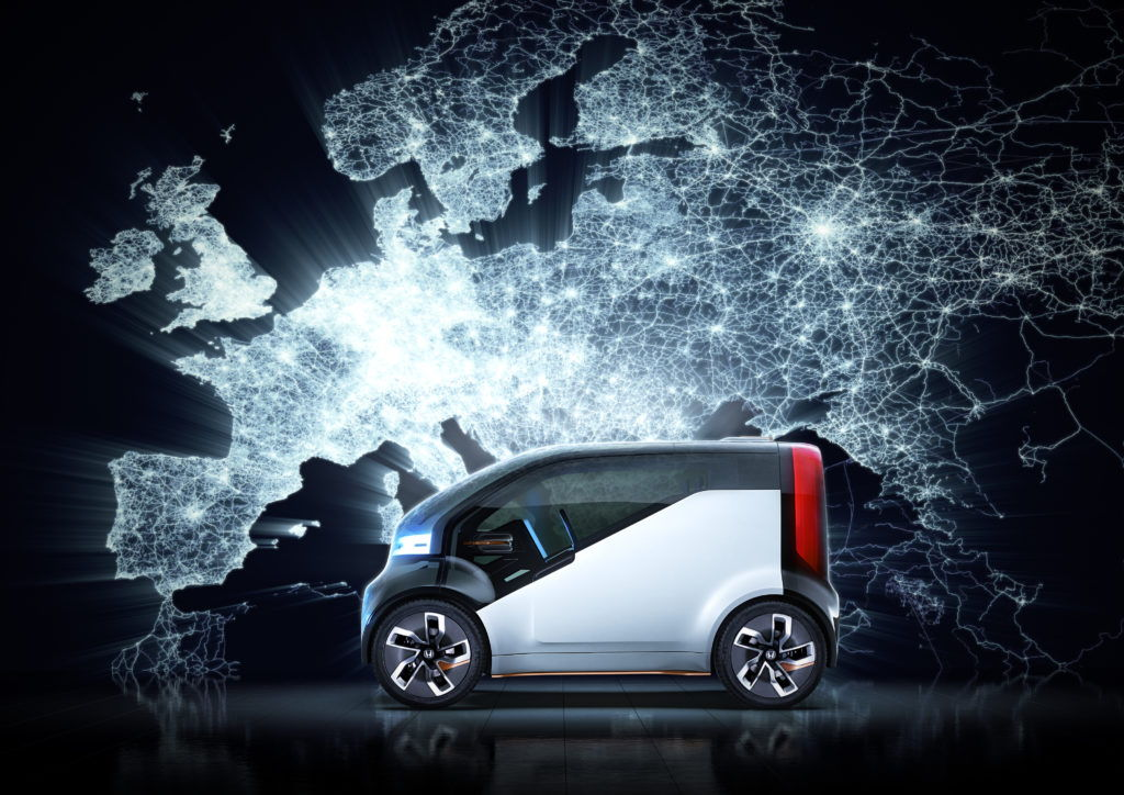 Honda neu-v car in front of CGI environment of a glowing map of europe