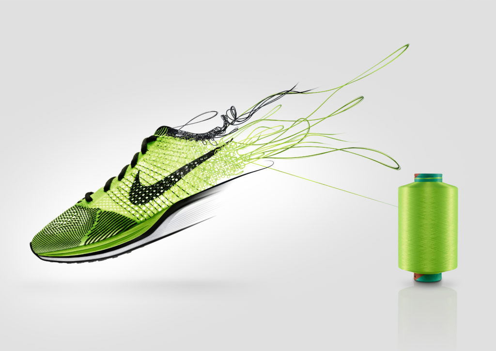 green nike flyknit trainer unravelling from a spool
