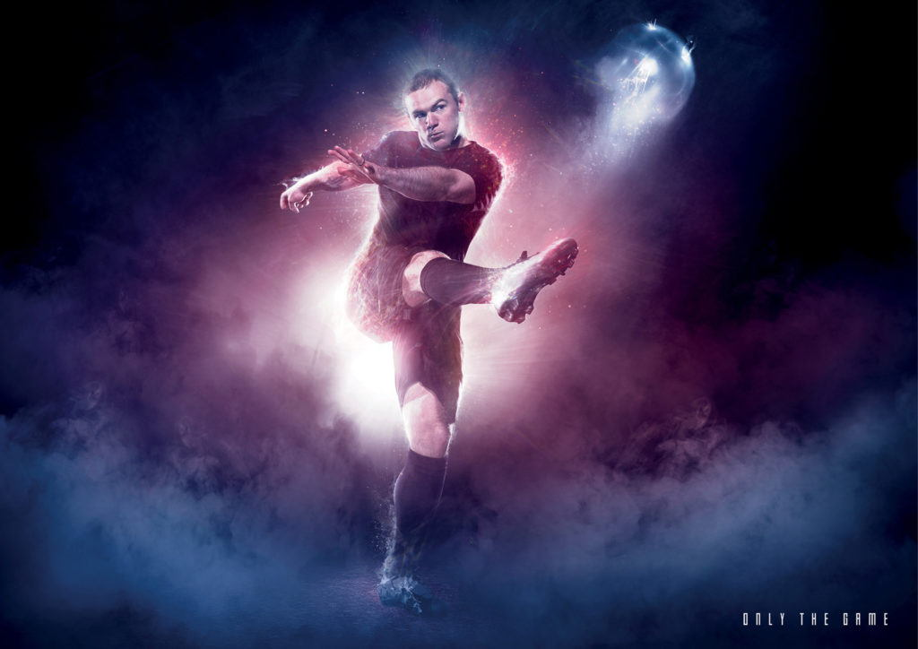 Wayne Rooney kicking a ball within a smokey environment