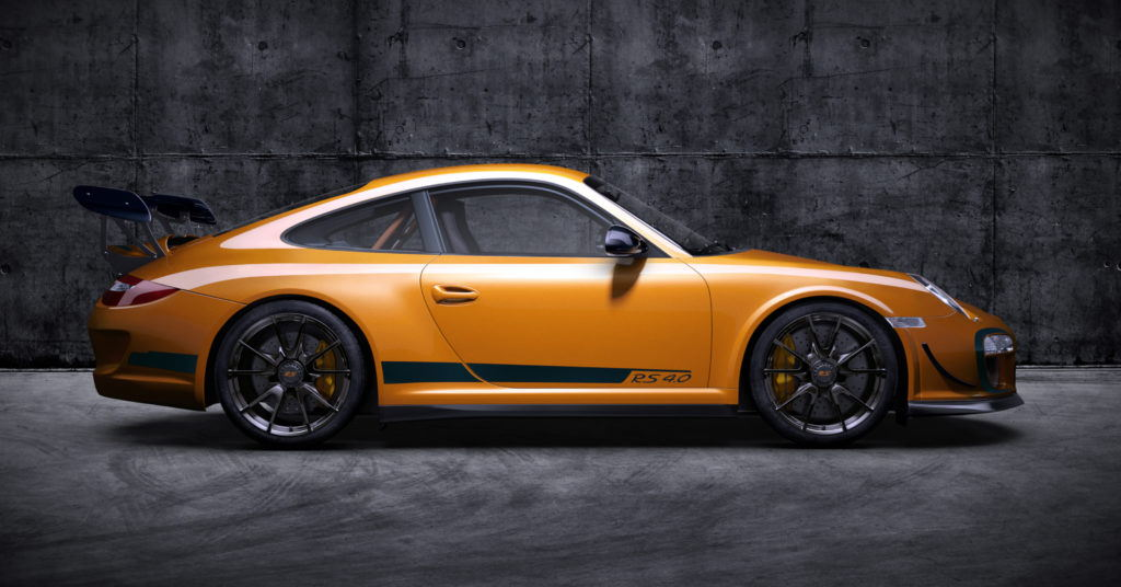 Orange Porsche in a concrete environment