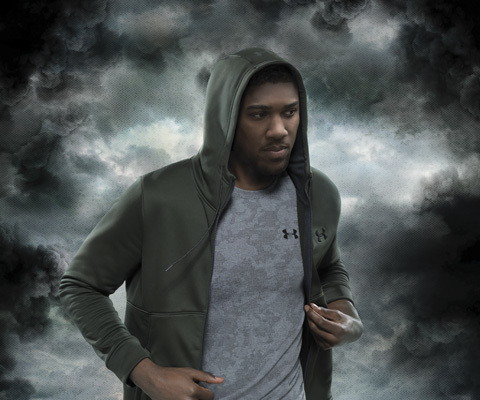 creative production featuring Anthony Joshua on a stormy background