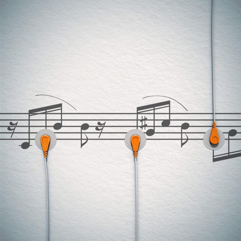 cgi illustration of a ecg sensor pad on a music sheet